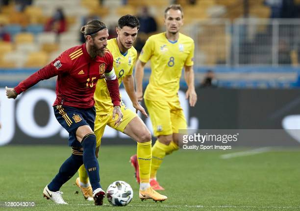 Roman Yaremchuk of Ukraine competes for the ball with Sergio Ramos of Spain during the UEFA Nations League group stage match between Ukraine and...