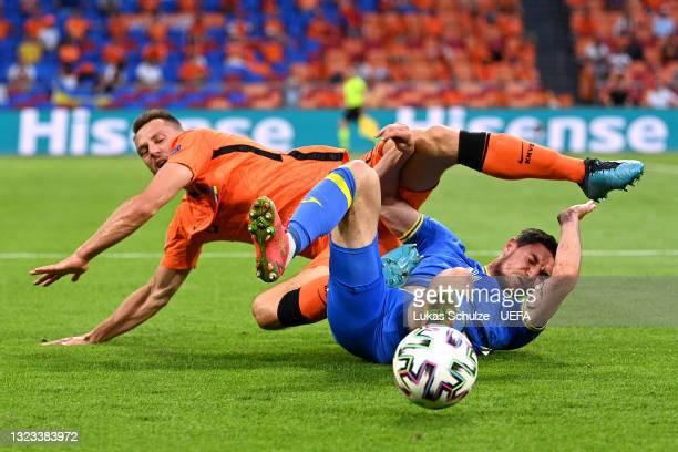 Roman Yaremchuk of Ukraine is challenged by Stefan de Vrij of Netherlands during the UEFA Euro 2020 Championship Group C match between Netherlands...
