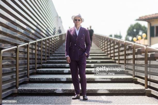 Roman Zaczkiewicz wearing a purple made to measure suit double breasted suit button down shirt white linen shirt cotton pocket square black penny...