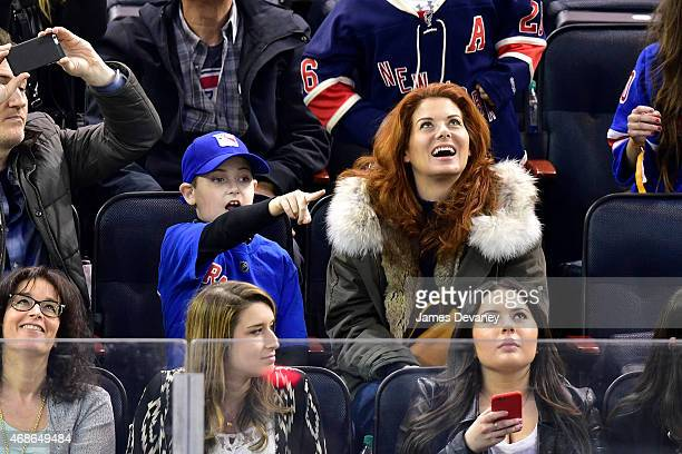 Roman Zelman and Debra Messing attend New Jersey Devils vs New York Rangers game at Madison Square Garden on April 4 2015 in New York City