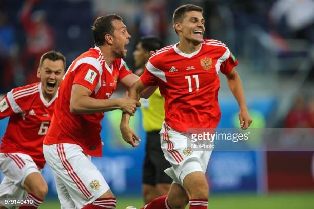 Roman Zobnin , Denis Cheryshev , Artem Dzyuba of the Russia national football team celebrates after scoring a goal during the 2018 FIFA World Cup...