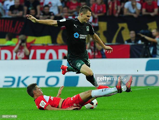 Roman Zobnin of FC Spartak Moscow and Artur Jedrzejczyk of FC Krasnodar vie for the ball during the Russian Premier League match between FC Spartak...