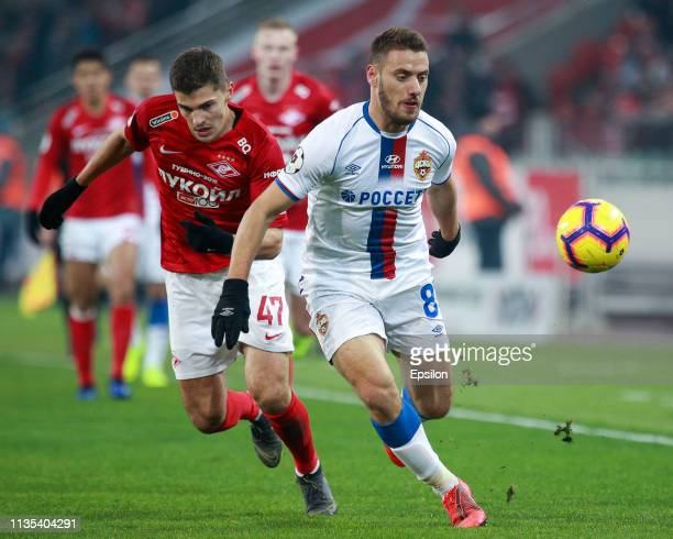 Roman Zobnin of FC Spartak Moscow vies for the ball with Nikola Vlasic of PFC CSKA Moscow during the Russian Premier League match between FC Spartak...