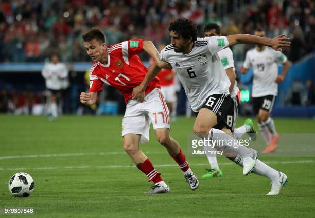 Roman Zobnin of Russia and Ahmed Hegazy of Egypt in action during the 2018 FIFA World Cup Russia group A match between Russia and Egypt at Saint...