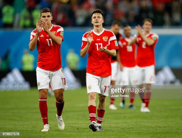 Roman Zobnin of Russia and Aleksandr Golovin of Russia applauds fans after their sides victory in the 2018 FIFA World Cup Russia group A match...
