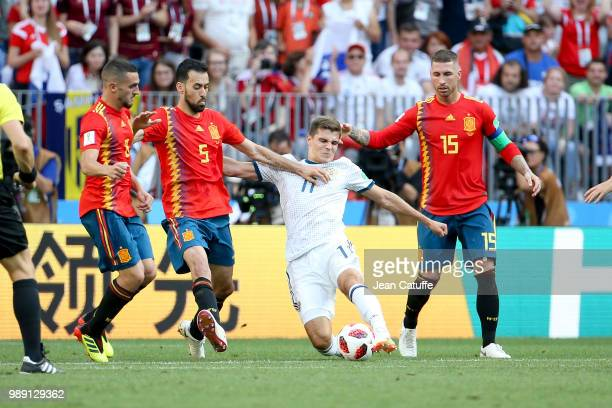 Roman Zobnin of Russia between Koke Sergio Busquets Sergio Ramos of Spain during the 2018 FIFA World Cup Russia Round of 16 match between Spain and...