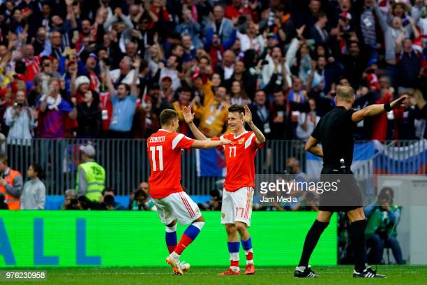 Roman Zobnin of Russia celebrates with Alexandr Golovin after scoring his team's fifth goal during the 2018 FIFA World Cup Russia group A match...