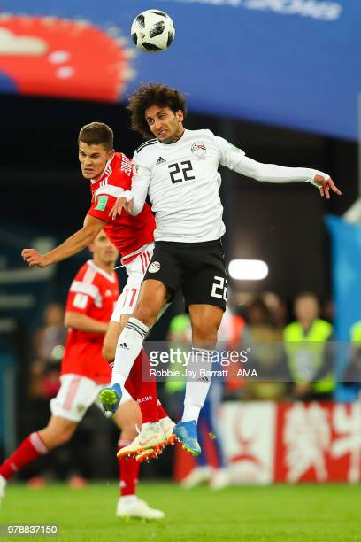 Roman Zobnin of Russia competes with Amr Warda of Egypt during the 2018 FIFA World Cup Russia group A match between Russia and Egypt at Saint...