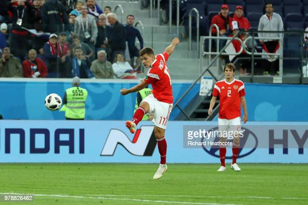 Roman Zobnin of Russia has a shot which is then deflected into the goal by Ahmed Fathi of Egypt scoring Russia's first goal during the 2018 FIFA...
