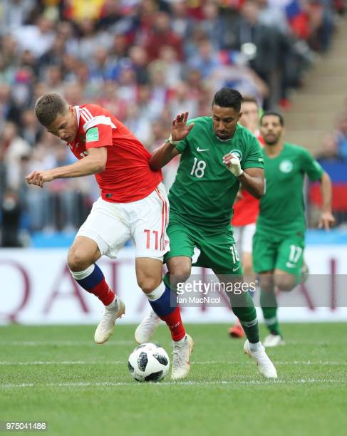 Roman Zobnin of Russia vies Salem Al Dossari of Saudi Arabia with during the 2018 FIFA World Cup Russia group A match between Russia and Saudi Arabia...