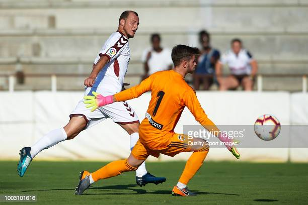 Roman Zozulia of Albacete balompie competes for the ball with Emilio Bernad of Valencia Mestalla during the PreSeason friendly match between Albacete...