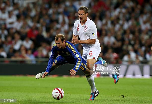 Roman Zozulia of Ukraine and Phil Jagielka of England collide during the FIFA 2014 World Cup qualifier group H match between England and Ukraine at...