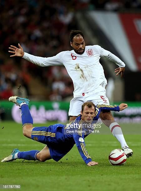 Roman Zozulia of Ukraine is brought down by Joleon Lescott of England during the FIFA 2014 World Cup qualifier group H match between England and...