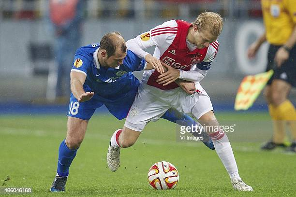 Roman Zozulya of FC Dnipro Dnipropetrovsk Nicolai Boilesen of Ajax during the Europa League round of 16 match between FC Dnipro Dnipropetrovsk and...