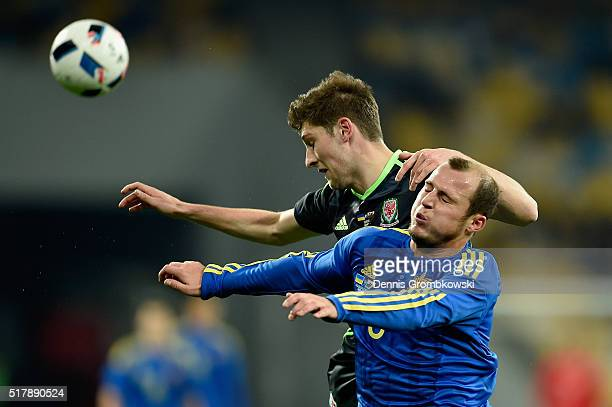 Roman Zozulya of Ukraine and Ben Davies of Wales battle for the ball during the International Friendly match between Ukraine and Wales at NSK...