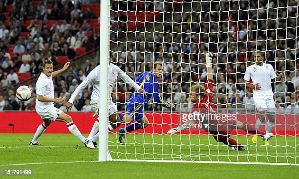 Roman Zozulya of Ukraine watches his shot go wide during the 2014 World Cup qualifying football match between England and Ukraine at Wembley Stadium...