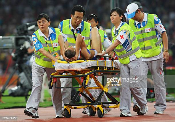 Romana Dubnova of Czech Republic is taken off the field on a gurney after an injury in the Women's High Jump Final held at the National Stadium on...