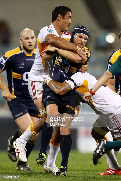 Romana Graham of the Chiefs tackles Matt Giteau of the Brumbies during the round one Super Rugby match between the Brumbies and the Chiefs at...