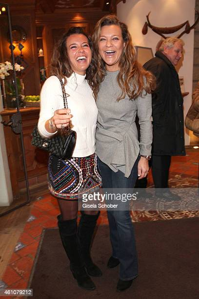 Romana Hinterseer and her daughter Laura pose during the NeujahrsKarpfenessen in Hotel zur Tenne on January 06 2015 in Kitzbuehel Austria