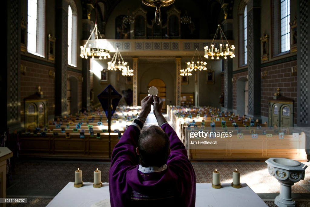 Austrian Priest Holds Daily Mass, His Congregation Represented By Photos : Nachrichtenfoto