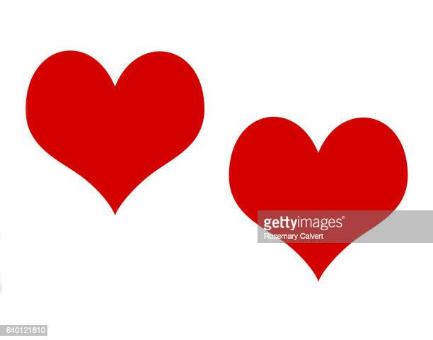 Romance and friendship represents by two red hearts on white.