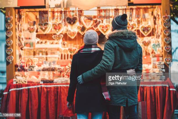 romance at christmas market - street market stock pictures, royalty-free photos & images
