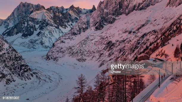 romance at glacier or mer de glace during blue hour (dusk) in winter. - chamonix stock pictures, royalty-free photos & images