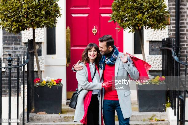 Romance couple embracing in front of red door