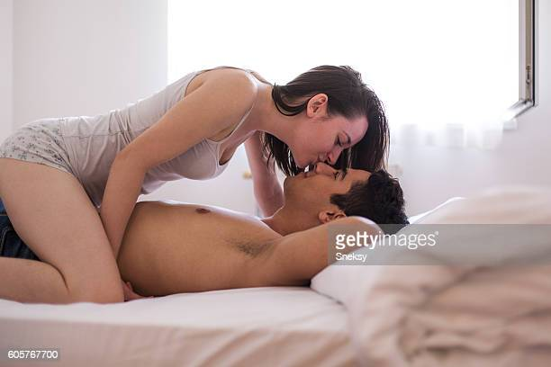 Romance couple kissing on the bed