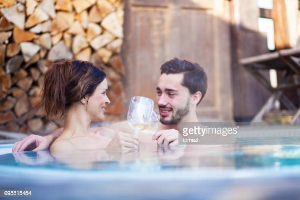 romance in hot tub - hot tub stock photos and pictures