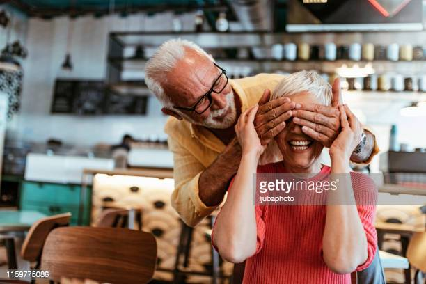 romance level: expert - hands covering eyes stock pictures, royalty-free photos & images
