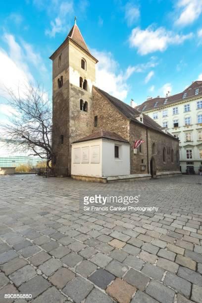 romanesque church of st rupert's in vienna, oldest church in the city, austria, a unesco heritage site - pflasterstein stock-fotos und bilder