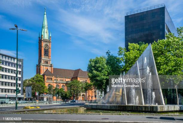 romanesque revival style st john's church (johanneskirche) and mack fountain, düsseldorf, north rhine-westphalia, germany, july 10, 2016 - mack stock pictures, royalty-free photos & images