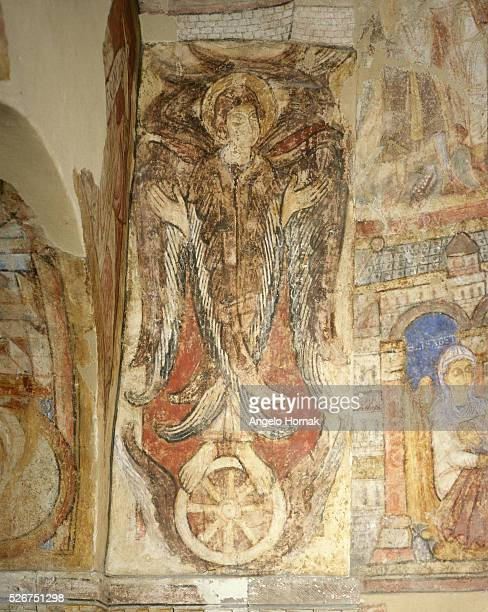 A Romanesque wall painting showing St Catherine with her wheel of martrydom at Canterbury Cathedral