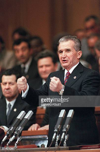 Romania communist party's general secretary and President Nicolae Ceaucescu's clenches his fists 24 November 1989 in Bucharest as he addresses the...