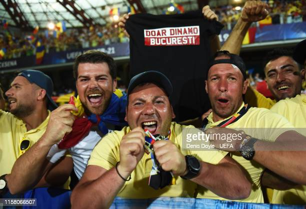 Romania fans celebrate after they qualified for the UEFA U21 semifinals after drawing 00 with France during the 2019 UEFA U21 Group C match between...
