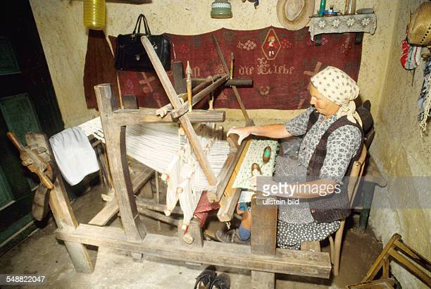 Romania: Local people in the village of Logic. A loom.