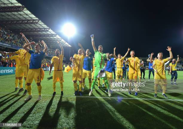 Romania players celebrate after they qualified for the UEFA U21 semifinals after drawing 00 with France during the 2019 UEFA U21 Group C match...