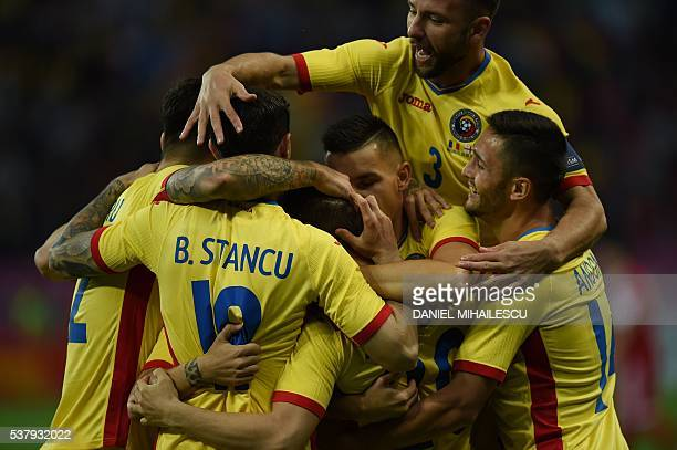 Romania players celebrate scoring during the preEuro 2016 friendly football match between Romania and Georgia in Bucharest on June 3 2016 / AFP /...