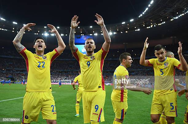 Romania players celebrate their team's first goal during the UEFA Euro 2016 Group A match between France and Romania at Stade de France on June 10...
