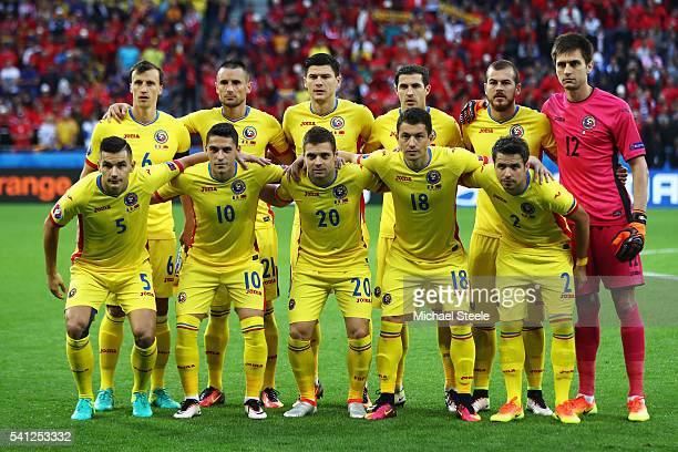 Romania players line up for the team photos prior to the UEFA EURO 2016 Group A match between Romania and Albania at Stade des Lumieres on June 19...