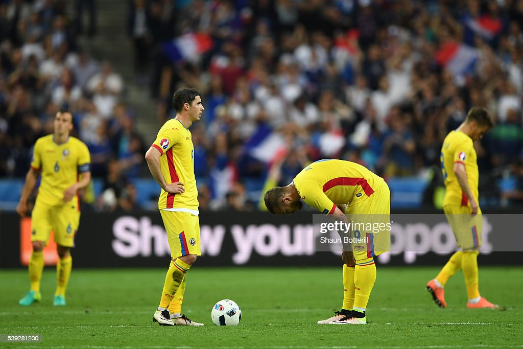 Romania players react after France's second goal during the UEFA Euro 2016 Group A match between France and Romania at Stade de France on June 10, 2016 in Paris, France.
