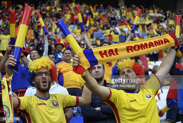 Romania supporters cheer ahead the Euro 2016 group A football match between Romania and Albania at the Parc Olympique Lyonnais stadium in Lyon on...