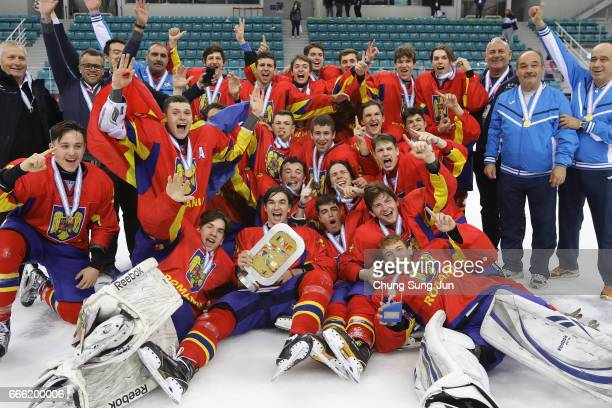 Romania team players celebrate after winning the 2017 IIHF Ice Hockey U18 World Championship Div II Group A between South Korea and Romania at the...