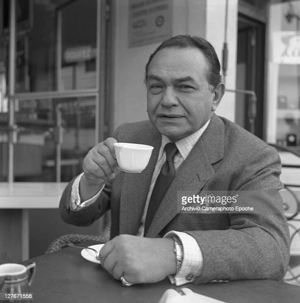 Romanian actor Edward G Robinson drinking coffee Cannes 1950
