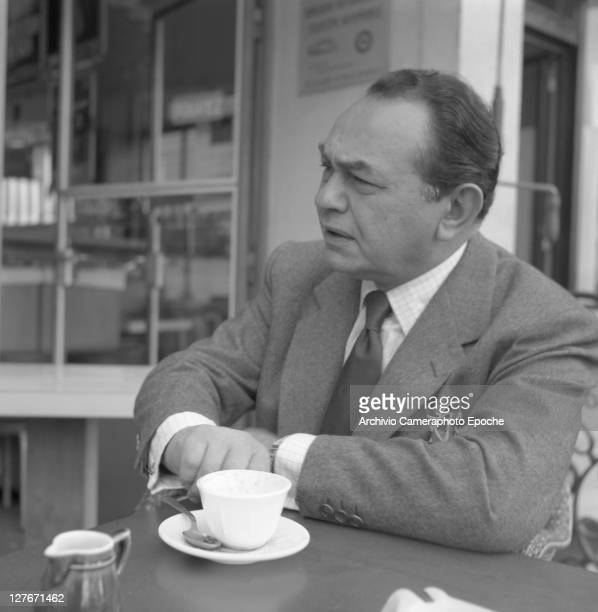 Romanian actor Edward G Robinson with a cup of coffee Cannes 1950