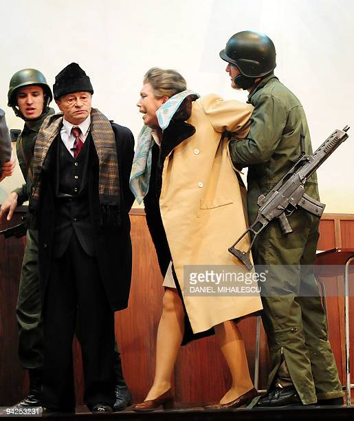 Romanian actors impersonating late communist dictator Nicolae Ceausescu and his wife Elena Ceausescu perform on the stage of the Odeon Theatre in...