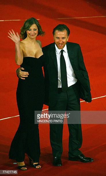 Romanian actress Alexandra Maria Lara waves next to English actor Tim Roth as they arrive for the premiere of US director Francis Ford Coppola last...