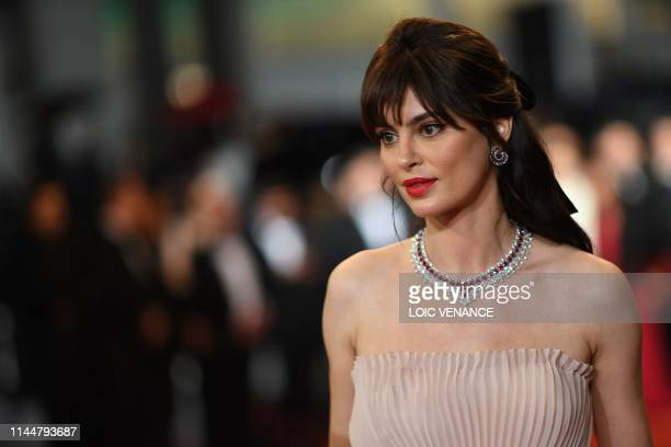 Romanian actress Catrinel Marlon arrives for the screening of the film The Whistlers at the 72nd edition of the Cannes Film Festival in Cannes...