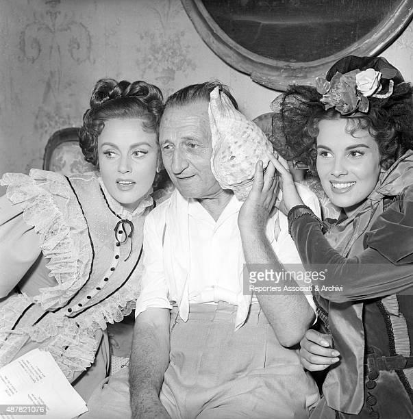 Romanian actress Nadia Gray and Italian Antonella Lualdi posing with director Carmine Gallone on the set of Casta diva Italy 1954